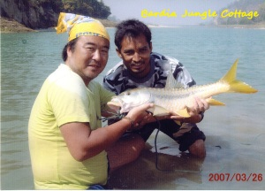 Koba from Japan (left) & Umanga, Nature Guide (right) with Golden Mahasheer